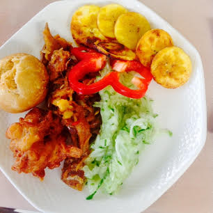 Breakfast in Nevis: Johnny cake, tania fritters, cucumber relish, plantain chips