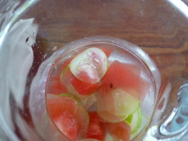 Slices of cucumber and watermelon add sunshine to water