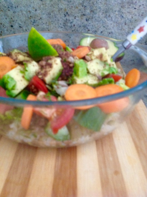 Unstyled: Quick lunch - brown rice topped with salad, seeds, avocado and steamed carrots